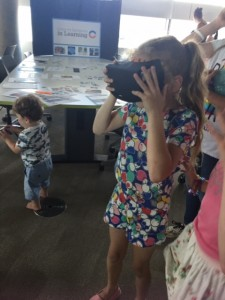 little girl using VR viewer
